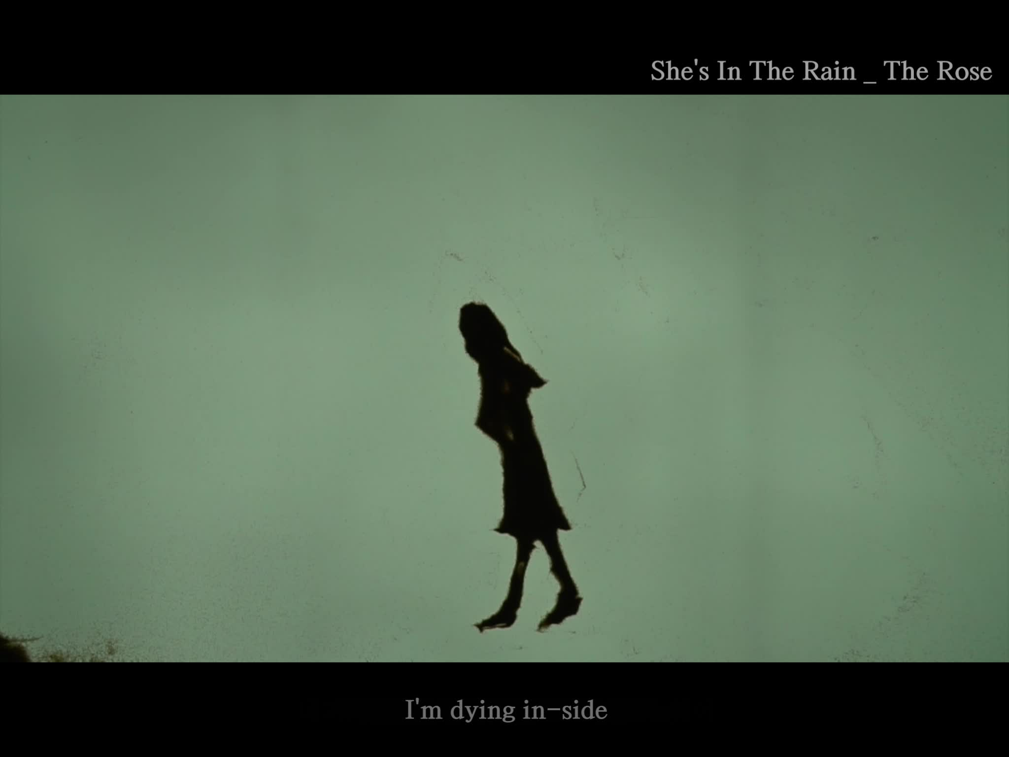 She's In the Rain Lyrics Video