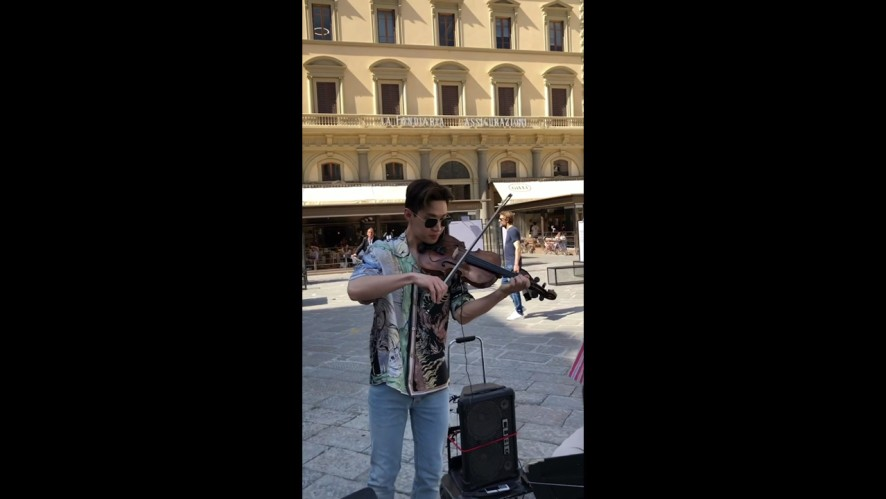 Henry and famous street violinist play a romantic duet using 1 violin